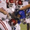The Oklahoma defense shuts down Kansas\' Darrian Miller (3) during the college football game between the University of Oklahoma Sooners (OU) and the University of Kansas Jayhawks (KU) on Saturday, Oct. 15, 2011. in Lawrence, Kan. Photo by Chris Landsberger, The Oklahoman