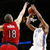 Oklahoma City\'s Russell Westbrook takes a shot past Anthony Parker of Toronto in the second half of the NBA basketball game between the Toronto Raptors and the Oklahoma City Thunder at the Ford Center in Oklahoma City, Friday, Dec. 19, 2008. The Thunder won, 91-83. BY NATE BILLINGS, THE OKLAHOMAN