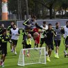 Photo - Spain's Gerard Pique, center, jumps over a mini soccer goal during a training session at the Atletico Paranaense training center in Curitiba, Brazil, Monday, June 9, 2014. Spain will play in group B of the Brazil 2014 soccer World Cup. (AP Photo/Manu Fernandez)
