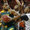 Baylor\'s Rico Gathers (2) goes past Oklahoma State\'s Marcus Smart (33) and Kamari Murphy (21) during an NCAA college basketball game between Oklahoma State University (OSU) and Baylor at Gallagher-Iba Arena in Stillwater, Okla., Saturday, Feb. 1, 2014. Baylor won 76-70. Photo by Bryan Terry, The Oklahoman