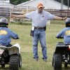 Photo - Instructor Mike Klumpp gives hand signals during a children's ATV safety course at the Logan County Fairgounds in Guthrie, OK, Friday, May 25, 2012,  By Paul Hellstern, The Oklahoman