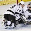 Los Angeles Kings\' Drew Doughty (8) and goalie Jonathan Quick look for the rebound on a shot from the Edmonton Oilers during the first period of their NHL hockey game, Tuesday, Feb. 19, 2013, in Edmonton, Alberta. (AP Photo/The Canadian Press, Jason Franson)