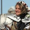 2013-2014 Czech/Slovak Queen Kalli Williams of Stroud waves to the crowd during the Czech Festival parade Saturday in Yukon. Photo by Hugh Scott, for the Oklahoman