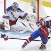 New York Rangers goaltender Martin Biron, left, makes a save against Montreal Canadiens\' Brian Gionta during the second period of an NHL hockey game in Montreal, Saturday, Feb. 23, 2013. (AP Photo/The Canadian Press, Graham Hughes)