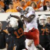 Oklahoma State\'s Brodrick Brown breaks up a pass intended for Arizona\'s Dan Buckner on Thursday. PHOTO BY BRYAN TERRY, The Oklahoman