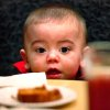 Jayden Romero, 14 months, stares at a dessert on the table in front of him at the 30th Edmond Community Thanksgiving Dinner in the George Nigh Student Center on the campus of University of Central Oklahoma, Thursday, Nov. 24, 2011. Romero attended the meal with his mother, Sarah, of Edmond, and grandmother. Photo by Jim Beckel, The Oklahoman