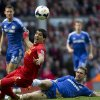 Photo - Liverpool's Luis Suarez, centre left, is thwarted by Chelsea's Branislav Ivanovic during their English Premier League soccer match at Anfield Stadium, Liverpool, England, Sunday, April 27, 2014. (AP Photo/Jon Super)