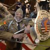 "Photo - Korean War veteran James McEachin, 82,  poses in front of the Rose Parade float ""Freedom Is Not Free"" by the Korean War Commemoration Committee, Saturday, Dec. 29, 2012, in Pasadena, Calif. McEachin is scheduled to ride the float in the Rose Parade on Tuesday, Jan. 1, 2013. (AP Photo/Mark J. Terrill)"