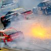 Photo - Drivers including Jamie McMurray (1) and Kurt Busch (78), atop Ryan Newman (39), collide as Brad Keselowski drives through the wreck in Turn 3 during the NASCAR Sprint Cup Series Aaron's 499 auto race at Talladega Superspeedway in Talladega, Ala., Sunday, May 5, 2013. (AP Photo/Greg McWilliams)