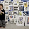 Photo - Samuel Reding, 4, finds his favorite piece of art to purchase in the Young-at-Art Mart during the Festival of the Arts on Thursday, April 24, 2014 in Oklahoma City, Okla.    Photo by Chris Landsberger, The Oklahoman