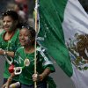 Photo - A couople of children, fans of the Mexican national soccer team, celebrate by the Independence Monument after their team tied with Brazil in their 2014 World Cup soccer match, in Mexico City, Tuesday, June 17, 2014. Mexico claimed a deserved point against Brazil in a largely frustrating Group A game which finished 0-0 at Estadio Castelao in Fortaleza, Brazil. (AP Photo/Rebecca Blackwell)