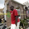 Royal Thornton waits in front of his tornado damaged home for his insurance adjuster to arrive Wednesday, April 4, 2012, in Forney, Texas. Thornton was not home when the house was hit by a tornado that left just the front part of the home standing. The mayor of Forney, Texas, says it\'s