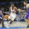 The Thunder\'s Jeff Green (22) drives the ball past the Kings\' Eugene Jeter (5) and Omri Casspi (18) during the NBA basketball game between the Oklahoma City Thunder and The Sacramento Kings on Tuesday, Feb. 15, 2011, Oklahoma City Okla. Photo by Chris Landsberger, The Oklahoman