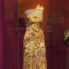This handout photo provided by the Smithsonian shows a dress designed by Indian-American designer Naeem Khan for first lady Michelle Obama. It was worn to the 2012 Governors Dinner and is now on display at the Smithsonian. (AP Photo/Smithsonian)