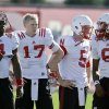 Photo - FILE - In this Aug. 13, 2014, file photo, Nebraska quarterbacks from left: Tommy Armstrong Jr. (4), Ryker Fyfe (17), Johnny Stanton (5) and AJ Bush (6) wait to begin stretches during team practice in Lincoln, Neb. (AP Photo/Nati Harnik, File)