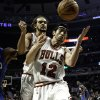 Chicago Bulls\' Kirk Hinrich (12) and Joakim Noah try to save the ball from going out of bounds during the first quarter against the Orlando Magic of an NBA basketball game in Chicago on Tuesday, Nov. 6, 2012. (AP Photo/Charles Cherney)