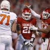 Oklahoma\'s Tom Wort (21) celebrates with Aaron Colvin (14) beside Oklahoma State\'s Parker Graham (71) during the Bedlam college football game between the University of Oklahoma Sooners (OU) and the Oklahoma State University Cowboys (OSU) at Gaylord Family-Oklahoma Memorial Stadium in Norman, Okla., Saturday, Nov. 24, 2012. Oklahoma won 51-48. Photo by Bryan Terry, The Oklahoman