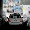 Photo - A vehicle transits a flooded underpass in San Rafael, Calif., on Sunday, Dec. 2, 2012, as utility workers work to repair a downed power line. Although sunny skies reappeared throughout the region Sunday afternoon, flood warnings remain for several rivers. (AP Photo/Noah Berger)