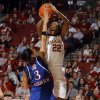 Oklahoma\'s DaShawn Harden (22) shoots over Kansas\' Angel Goodrich (3) during the women\'s college basketball game between the Oklahoma Sooners and the Kansas Jayhawks at the LLoyd Noble Center in Norman, Okla., Sunday, March, 4, 2011. Photo by Sarah Phipps, The Oklahoman