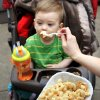 Maxwell Goodner is fed three-cheese macaroni by his mother, Heather at the opening day of the 2010 Festival of the Arts in downtown Oklahoma City, Tuesday, April 20, 2010. Also shown is an Indian taco. The event runs through Sunday. Photo by Jim Beckel, The Oklahoman