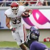 Oklahoma\'s Trey Millard (33) avoids a tackle attempt by TCU\'s Kenny Cain (51) during the college football game between the University of Oklahoma Sooners (OU) and the Texas Christian University Horned Frogs (TCU) at Amon G. Carter Stadium in Fort Worth, Texas, on Saturday, Dec. 1, 2012. Photo by Steve Sisney, The Oklahoman