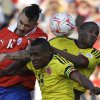 Photo -   Chile's Mauricio Pinilla, left, fights for the ball with Colombia's Amaranto Perea, center, and Colombia's Edwin Valencia during a World Cup 2014 qualifying soccer game in Santiago, Chile, Tuesday, Sept. 11, 2012. (AP Photo/Eduardo Di Baia)