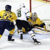Photo - Dallas Stars right wing Reilly Smith (18) scores against Nashville Predators goalie Pekka Rinne (35), of Finland, in the second period of an NHL hockey game on Monday, Feb. 25, 2013, in Nashville, Tenn. Also defending against Smith is Scott Hannan (22). (AP Photo/Mark Humphrey)