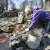 Twnna Heslip, a friend of the owner of this home which burned at 1001 Pacific Dr. in Choctaw, Oklahoma, sifts through the rubble for salvageable items, Saturday, April 11, 2009. Photo by Paul Hellstern, The Oklahoman