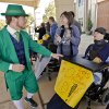 The Notre Dame mascot greets patients as the
