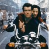 FILE - This undated publicity file photo provided by BMW, shows Pierce Brosnan, as Bond, and Michelle Yeoh, as the Bond-girl, Wai Lin, in a scene from the James Bond 1997 movie