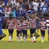 United States teammates celebrate a goal by Mix Diskerud (8) against El Salvador during the second half in the quarterfinals of the CONCACAF Gold Cup soccer tournament on Sunday, July 21, 2013, in Baltimore. The United States won 5-1. (AP Photo/Patrick Semansky)