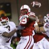 Nebraska\'s Barry Turner (99) breaks up a pass for Oklahoma\'s DeMarco Murray (7) during the first half of the college football game between the University of Oklahoma Sooners (OU) and the University of Nebraska Cornhuskers (NU) on Saturday, Nov. 7, 2009, in Lincoln, Neb. Photo by Chris Landsberger, The Oklahoman