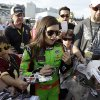 Danica Patrick signs autographs for fans after her qualifying run for Saturdays NASCAR Nationwide Series auto race, Friday, Feb. 22, 2013, at Daytona International Speedway in Daytona Beach, Fla. (AP Photo/Chris O\'Meara) ORG XMIT: DBR221