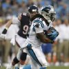 Photo - Carolina Panthers running back DeAngelo Williams (34) carries the ball as Chicago Bears defensive end Shea McClellin (99) pursues during the first half of a preseason NFL football game in Charlotte, N.C., Friday, Aug. 9, 2013. (AP Photo/Chuck Burton)