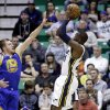 Utah Jazz\'s Paul Millsap, right, shoots against Golden State Warriors\' David Lee (10) in the first quarter during an NBA basketball game Tuesday, Feb. 19, 2013, in Salt Lake City. (AP Photo/Rick Bowmer)