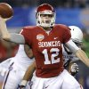 Oklahoma\'s Landry Jones (12) throws a pass during the Cotton Bowl college football game between the University of Oklahoma (OU)and Texas A&M University at Cowboys Stadium in Arlington, Texas, Friday, Jan. 4, 2013. Oklahoma lost 41-13. Photo by Bryan Terry, The Oklahoman