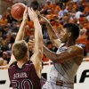OSU\'s Marcus Smart (33) passes the ball away from Nathan Scheer (30) of Missouri State during a men\'s college basketball between Oklahoma State University and Missouri State at Gallagher-Iba Arena in Stillwater, Okla., Saturday, Dec. 8, 2012. OSU won, 62-42. Photo by Nate Billings, The Oklahoman
