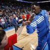 Oklahoma City\'s Royal Ivey (7) greets a fan before the NBA basketball game between the Oklahoma City Thunder and the Sacramento Kings at Chesapeake Energy Arena in Oklahoma City, Friday, April 13, 2012. Oklahoma City won, 115-89. Photo by Nate Billings, The Oklahoman
