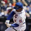 Photo - New York Mets' Curtis Granderson hits an RBI double during the first inning of the baseball game against the Washington Nationals at Citi Field, Thursday, April 3, 2014 in New York. (AP Photo/Seth Wenig)