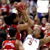 Ashley Paris blocks a shot by Monique Reid on the Cardinals\' last possession in the second half as the University of Oklahoma plays Louisville at the 2009 NCAA women\'s basketball tournament Final Four in the Scottrade Center in Saint Louis, Missouri on Sunday, April 5, 2009. Photo by Steve Sisney, The Oklahoman