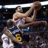 Toronto Raptors forward Linas Kleiza (11) drives to the hoop past Utah Jazz guard Jamaal Tinsley (6) during the first half of an NBA basketball game in Toronto on Monday, Nov. 12, 2012. (AP Photo/The Canadian Press, Frank Gunn)