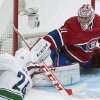 Montreal Canadiens goaltender Carey Price makes a save against Vancouver Canucks\' Raphael Diaz during the second period of an NHL hockey game Thursday, Feb. 6, 2014, in Montreal. (AP Photo/The Canadian Press, Graham Hughes)