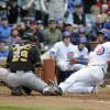 Photo - Chicago Cubs' Starlin Castro, right, is safe at home as Pittsburgh Pirates catcher Tony Sanchez (26) makes a late tag during the fourth inning of a baseball game on Thursday, April 10, 2014, in Chicago. (AP Photo/David Banks)