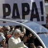 Pope Benedict XVI waves as he arrives for his last general audience in St. Peter\'s Square at the Vatican, Wednesday, Feb. 27, 2013. Tens of thousands of people toting banners saying