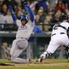 Seattle Mariners catcher Jesus Sucre, right, waits for the throw as Texas Rangers\' Elvis Andrus scores in the 11th inning in a baseball game Sunday, May 26, 2013, in Seattle. (AP Photo/Elaine Thompson)