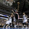 Portland Trail Blazers power forward LaMarcus Aldridge, center, goes up for a shot as Dallas Mavericks\' DeJuan Blair (45) and Monta Ellis (11) defend during the first half of an NBA basketball game, Saturday, Jan. 18, 2014, in Dallas. (AP Photo/Tony Gutierrez)