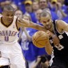 NBA BASKETBALL: Oklahoma City\'s Russell Westbrook (0) attempts to steal from San Antonio\'s Tony Parker (9) during Game 3 of the Western Conference Finals between the Oklahoma City Thunder and the San Antonio Spurs in the NBA playoffs at the Chesapeake Energy Arena in Oklahoma City, Thursday, May 31, 2012. Photo by Sarah Phipps, The Oklahoman
