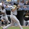 Photo - Pittsburgh Pirates' Neil Walker hits and RBI single during the fifth inning of the first baseball game of a double-header against the New York Yankees at Yankee Stadium, Sunday, May 18, 2014 in New York. (AP Photo/Seth Wenig)