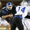 Deer Creek\'s Caden Sander rolls out against Guthrie during a high school football game at Deer Creek in Oklahoma City, Friday, October 25, 2013. Photo by Bryan Terry, The Oklahoman