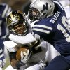 Edmond North\'s Sam Delzell tries to bring down Midwest City\'s Cornell Neal during their high school football game at Wantland Stadium in Edmond, Thursday, October 25, 2012. Photo by Bryan Terry, The Oklahoman